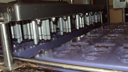 Pump-driven chocolate depositor for mould filling