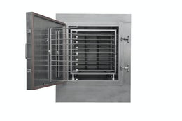 Vacuum tray dryer with clean, in-place system
