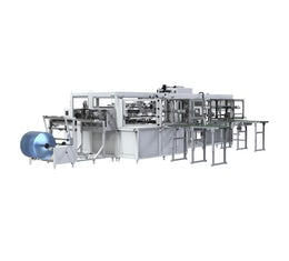 Automatic laminating machine for pulp-based trays