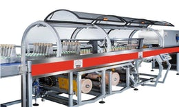 Shrink wrapping machine for PET bottles